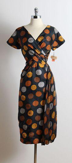 1950's Ferman O'Grady black dot print silk dress, acetate lining, left sheer silk sash accent, metal back zipper, with original tags