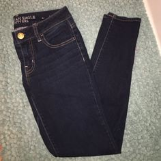 EUC American Eagle Jeans Dark denim, size 0, skinny leg. Perfect condition, only worn a handful of times. Available for less on merc. American Eagle Outfitters Jeans Skinny