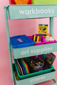 Homeschool Organization: How to Make a DIY Slim Rolling Cart - The Pretty Life Girls | Since we aren't your typical homeschoolers, we don't have a classroom with shelves or storage for school stuff, so we've had to get organized! We turned to our trust rolling card to help us get it together. These things are such a catch-all in both of our homes and by adding some labels and containers, we have converted one to a homeschool-on-wheels to keep things organized and give everything a place.
