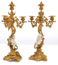 A PAIR OF 19TH CENTURY FRENCH GILT BRONZE CANDELABRAWITH BISQUE PORCELAIN FIGURAL MOUNTS