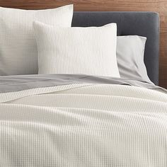 Our updated quilt bedding dresses the bed with intricate, small-scale stitching for rich depth and texture. Crafted of polyester and viscose in a versatile shade of cream, the bed linens have a slight sheen that makes them look modern. Quilts and shams are backed with cotton sheeting, filled with cotton and trimmed with cotton piping.