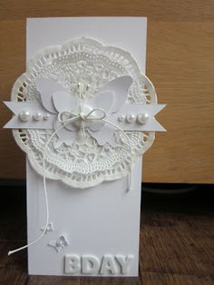 handmade birthday card from Crea Vera blog ... white one white ... die cuts and pearls ... lacy doily  cuts and plain buttterfly cuts .. luv the graphic BDAY ... tall and thin format ... great card!