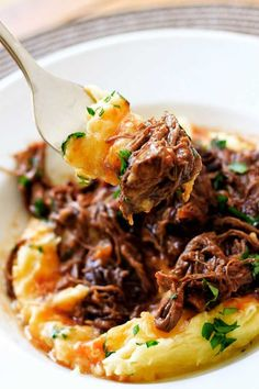 A forkful of short rib ragu with parmesan mashed potatoes