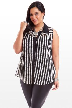 Bold black and white, subtle lace detail. This sleeveless top packs a ton of style, thanks to the striped print meets black colorblocking along the collar, button placket, and sheer chiffon back. Shirred front and back yoke boast a see-through lace fabric, adding unexpected and winning texture. Oversized drape keeps it slouchy and effortless. Pair with silver or black and rhinestone-flecked jewelry, and it's a fashion game, set, match.