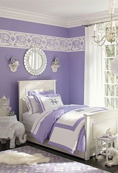 """The purple walls are very sweet. It makes my mouth watery! The pillow has an """"N"""" on it!"""