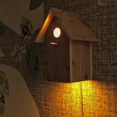 ...finding other uses for a birdhouse. I'm in love with this.