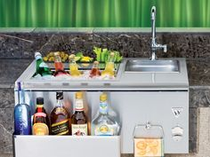 Outdoor Beverage Center: The insulated ice compartment holds up to 40 lbs. of ice. Three specially designed compartments keep beverages cool and condiments fresh. Available at Rich's for the Home.