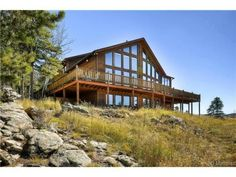 8485 Armadillo Trl  Evergreen, CO 80439 - First time on the market!  Huge interior spaces, sweeping views of Mt. Evans and snowcapped peaks, shows beautifully inside & out!