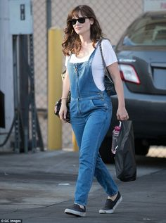 Laid-back look: Zooey Deschanel ditched her typical bold sartorial choices and opted for comfort in denim overalls as she made an appearance on Jimmy Kimmel Live on Tuesday