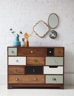 This unique chest of drawers is made of solid mango wood with a warm cherry finish. It comes with 11 roomy drawers finished in 4 different colours and with an eclectic range of handles.