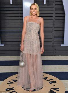 A vision: Margot made a stunning entrance at the 2018 Vanity Fair Oscar party on Sunday ev... #oscars