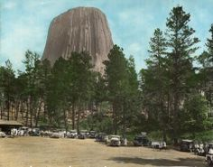 Devils Tower with visitors, 1930, hand colored. From the Wyoming State Archives.