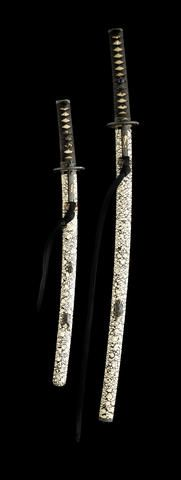 A fine and rare Kinko Koshirae Daisho-set. The fittings by Hamano Masanobu (born 1773) Edo Period, early 19th century. The saya is finely lacquered applied with a coiled snake in shibuichi takazogan, signed Miboku with kao and kuchigane in the form of a slug, the fittings of shakudo ishime, inlaid with various insects, the tsuba of oval form, inlaid with butterflies in gold, silver and copper takazogan, A rare sword indeed.