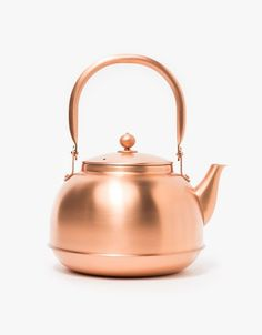 From Azmaya, a premium copper kettle with minimalist styling, nickel lining, hinge top handle, spout and top with handle and small vent hole. Copper Tea Kettle, Teapots Unique, Dining Ware, Kitchen Items, Kitchen Stuff, Kitchen Gadgets, Kitchen Decor, Copper Kitchen, My Cup Of Tea