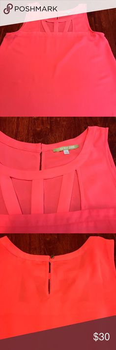 Gianni Bini coral top Gianni Bini sleeveless coral colored blouse with cut outs high on chest. No flaws Gianni Bini Tops Blouses