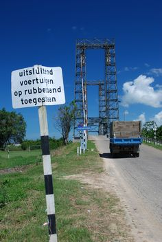 Steel bridge on the way from Paramaribo to Nickerie. The sign says: Only vehicles on rubber tires permitted.