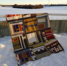 Not your typical modern fabric or color palette. Dig it.  QAYG Improvised Quilt by Marianne, featured on her blog.