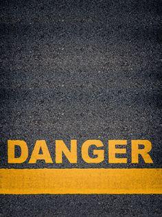 Danger Asphalt Road Markings - Conceptual Image Of Danger As Yellow Asphalt Road Markings With Single Line And Copy Space