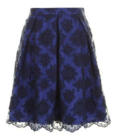 Demure and dreamy, this sweetly styled skirt embodies the nostalgic romance of classic couture. Boasting a lovely lace overlay and a full lining, this pretty piece is pouring with charm.Measurements (size S): 19'' long55% nylon / 45% cottonLining: 100% polyesterHand wash; dry flat