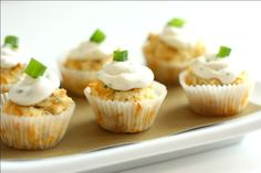 "Savory cheddar cupcakes with cheese ""frosting."" Rosemary and cilantro are in these little gems...my fav herbs."