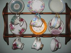 I have a vintage tea-cup rack like this and some vintage tea cups and saucers. May spray paint the rack white (to make it more modern) and hang in my living rooom. Wood Wall Shelf, Wall Shelves, Tea Cup Saucer, Tea Cups, Tea Cup Display, Vintage Tea, Vintage Antiques, Solid Wood, Decorative Plates