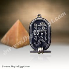 Silver wide cartouche Pendant with filigree border and dark back ground. A unique Silver Egyptian cartouche with a Wide Dark back ground and Filigree border personalized by translating your name into the beautiful Ancient Egyptian hieroglyphic symbols.