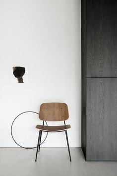 Søborg chair designed by Børge Mogensen in 1952 available from Fredericia. Danish design minimal styling by April and May. Black, white and wood Scandianvian style.