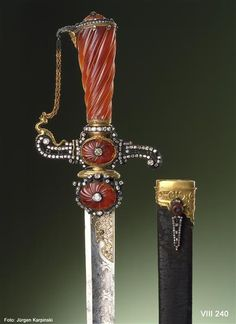 Sword with scabbard and a diamond and carnelian grip.