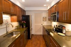 Galley kitchens need not be small or dark or lacking storage. Just look at this luxury galley kitchen.: Modern Galley Kitchen with Wood Cabinets and Floor Galley Kitchen Design, Small Galley Kitchens, Small Space Kitchen, Kitchen On A Budget, Cool Kitchens, Kitchen Ideas, Kitchen Designs, Kitchen Tips, Wood Kitchen Cabinets