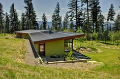 passive solar, earth berm: modern exterior by Mohler + Ghillino Architects
