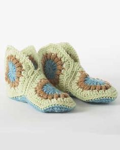 Granny Slippers (crochet)   Free pattern     Funky crocheted slippers crafted from granny squares. Shown in Bernat Super Value.