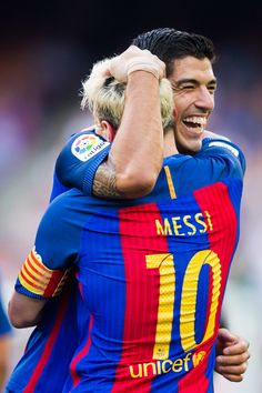 Luis Suarez of FC Barcelona celebrates with his teammate Lionel Messi after…