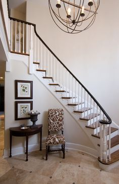 Get a large light fixture for entryway at new house- will help take away from the large wall