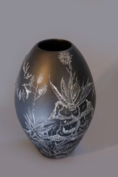 "Eunice Botes Ceramics -""The white succulents between the rocks""  Black porcelain with sqraffito and sprigs"