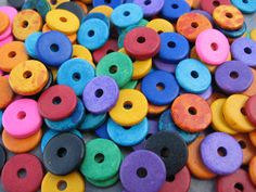 These Greek Ceramic beads are the BRIGHT ASSORTMENT of the Greek Ceramic Beads and are a wonderful collection of bright colors. You will receive 25 of these large holed Greek Ceramic beads in the style of BRIGHT ASSORTMENT Round Washer - Disk. They are also known as discs, spacers, rondelles and roundels. 13mm disks = 1/2 inch 2 1/2 mm to 3mm thick 2 1/2 mm to 3mm hole If you need more just contact me and I can put up a listing for you. If you would like to see addit...