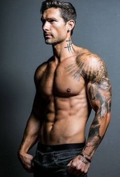 At least I don't feel like a complete cougar ogling this guy. Hot tattoos and muscles, yum!