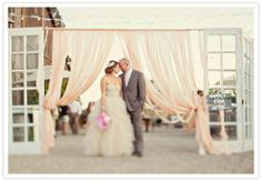 fabric between old doors - ceremony backdrop! I like!!!