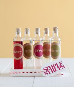 Inspiration - Simple Syrups for soda water or alcohol mixers. No recipe or label download but the bottles can be obtained at the Container Store here: http://www.containerstore.com/shop?productId=10019593&N=&Ntt=glass+bottle Font used on labels:  Caslon Graphique