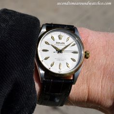 Today I'm sporting a 1957 Vintage Rolex Oyster Perpetual Ref. 6564 Two-tone timepiece. This example features a 14K yellow gold, smooth bezel, a stainless steel watch case, and a patinated silver dial with applied, yellow gold elongated arrow markers. This Rolex also comes equipped with a 25-jewel, automatic caliber 1030 movement. (Store Inventory # 9684, listed at $3050.)  #rolex #twotone #silver #dial #oyster #perpetual #classic #watches #cool #vintage #wristwatches #timepieces #watch…