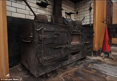 Victorian Kitchen from the 1830s Uncovered in U.K.  The preserved Victorian stove is just one piece in a huge kitchen hidden for decades in the basement.