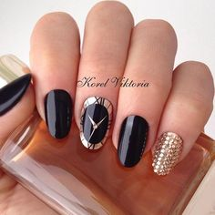 A luxury holiday solution offers a glossy black manicure with a gold. What is luxury? It has many manifestations, among them are expensive watches and jewe