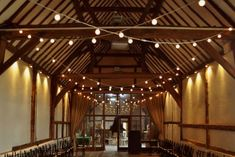 Wedding lighting at Bix Manor by Oakwood Events. Including fairy light canopies, festoon lights, chandeliers, Edison bulbs, uplighting and more. Canopy Lights, Ceiling Canopy, Ceiling Lights, Festoon Lights, Event Lighting, Barn Lighting, Wedding Lighting, Paper Lanterns, Fairy Lights