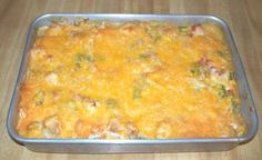 """The King of all Casseroles-  easy and inexpensive to make.  9 x 13 pan will feed @ 8 adults. similar to  enchiladas:   very good reheated//  1 Medium Pepper   1 Medium Onion   2 cans of Cream of Chicken Soup   2 cans of Rotel   3 Boneless Chicken Breast   9 8"""" Tortillas   12 oz. Shredded Cheddar Cheese   8 oz. Mozzerella Cheese"""