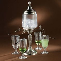 Absinthe fountain. The set is the same type used in La Louche, an ubiquitous ritual performed at French absinthe cafes in the 19th-century. Ice water is slowly released from the fountain over a sugar cube that is held by the slotted spoon as it rests atop the absinthe-filled glass. As the water drips from the spigot, it dissolves the sugar into the absinthe, creating the milky, iridescent cocktail favored by Vincent Van Gogh and Pablo Picasso.