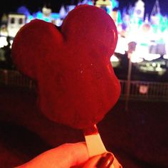 Never turn down free Mickey Ice Cream Bars! #mickeybar #icecream #disneyland #itsasmallworld #comeonpaintthenight #disneylife by bootsandmickeyears