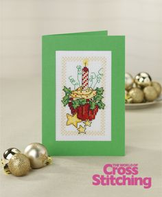 Cupcake of the month - Christmas cross stitch cake card idea. Chart in The World of Cross Stitching magazine, issue 196