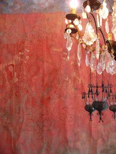 Pink damask wallpaper & chandelier