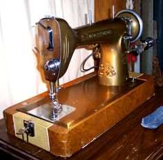 This vintage New Home straight-stitch machine doesn't use a belt.  It has a positive-contact, friction-pulley.  Also it looks really cool.