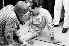 1959 An exhausted Jack Brabham after pushing his car over the line to secure his first world championship