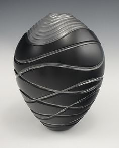 """Nick Leonoff """"Armor""""   carved blown glass http://www.morganglassgallery.com/imagepages/leonoff_armor.htm"""